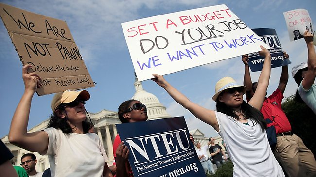 Furloughed federal workers protest outside the US Capitol to demand an end to the lockoutcaused by the government shutdown. Overnight, the Pentagon ordered employees back to work and lawmakers voted that public servants would get backpay once the shutdown ends. Picture: Getty