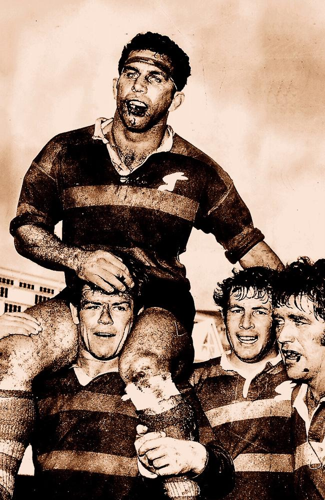 Captain John Sattler is chaired from the field with a broken jaw by Bob McCarthy with aid of teammates Mike Cleary and John O'Neill (R) after Souths defeated Manly in 1970