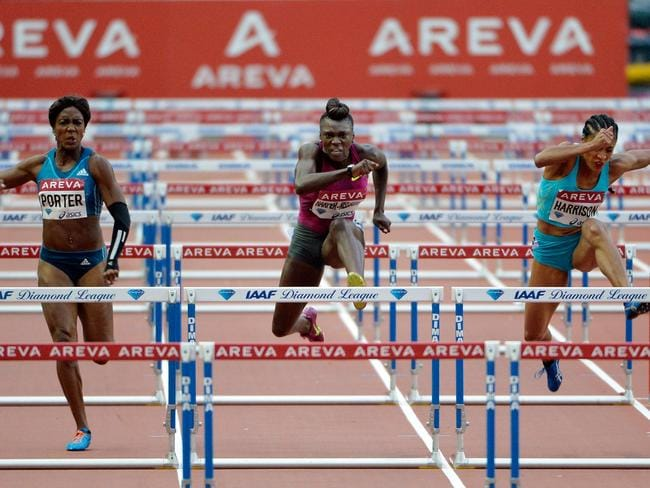 USA's Dawn Harper-Nelson (C) competes to win the women's 100m hurdles event, alongside second-placed USA's Queen Harrison (R) and British-American Tiffany Porter (L).
