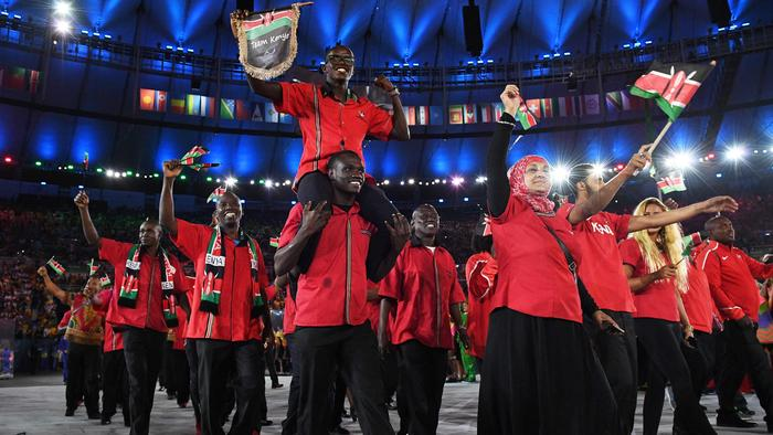 (FILES) This file photo taken on August 06, 2016 shows members of the Kenya delegation entering the stadium during the opening ceremony of the Rio 2016 Olympic Games at the Maracana stadium in Rio de Janeiro. With long distance runners elevated to national heroes, Kenya probably thought it would make disappear its old demons of doping and corruption during the Rio Olympics, but the Kenyan delegation distinguished itself by escapades as sparkling as his athletic performance. / AFP PHOTO / Leon NEAL