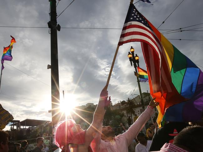 Pride event ... gay rights supporters wave a rainbow pride flag and an American flag during a gay pride celebration in San Francisco on June 27. Picture: Elijah Nouvelage/Getty Images/AFP