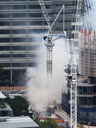 A crane has caught on fire at the Barangaroo construction site in Sydney causing traffic chaos around the CBD and workers to be evacuated with a risk of the crane collapsing. Picture: Toby Zerna