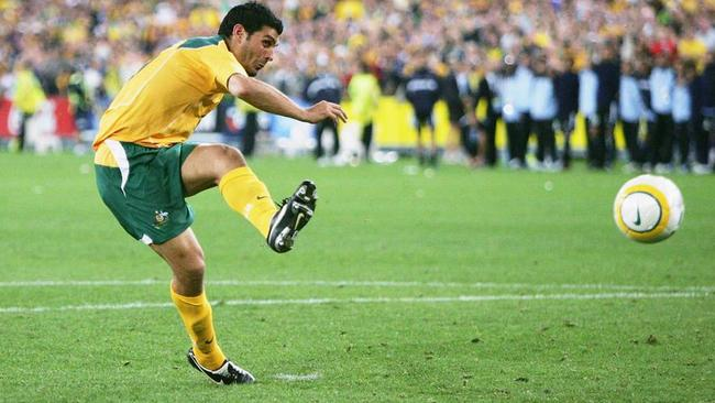 SYDNEY, NSW - NOVEMBER 16: John Aloisi of Australia scores the winning goal in the penalty shoot-out during the second leg of the 2006 FIFA World Cup qualifying match between Australia and Uruguay at Telstra Stadium November 16, 2005 in Sydney, Australia. (Photo by Adam Pretty/Getty Images)