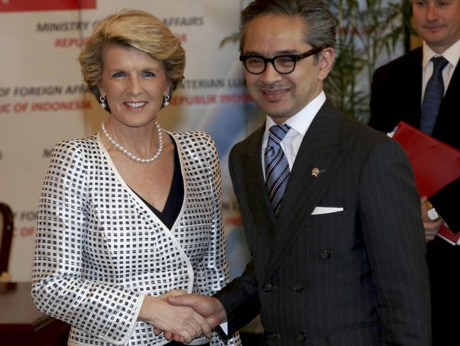 Australian Foreign Minister Julie Bishop, left, is greeted by his Indonesian counterpart Marty Natalegawa prior to their meeting in Jakarta, Indonesia in 2013. Picture: Tatan Syuflana
