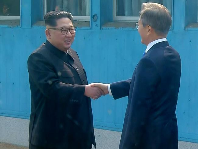 The two leaders shake hands as Kim crossed the border into South Korea. Picture: Korea Broadcasting System/AP