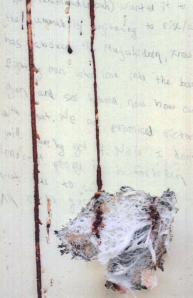 The bloodstained note was scrawled on the fibreglass hull of the boat Dzhokhar Tsarnaev was found hiding in. Picture: AP Photo/U.S. Attorney's Office.