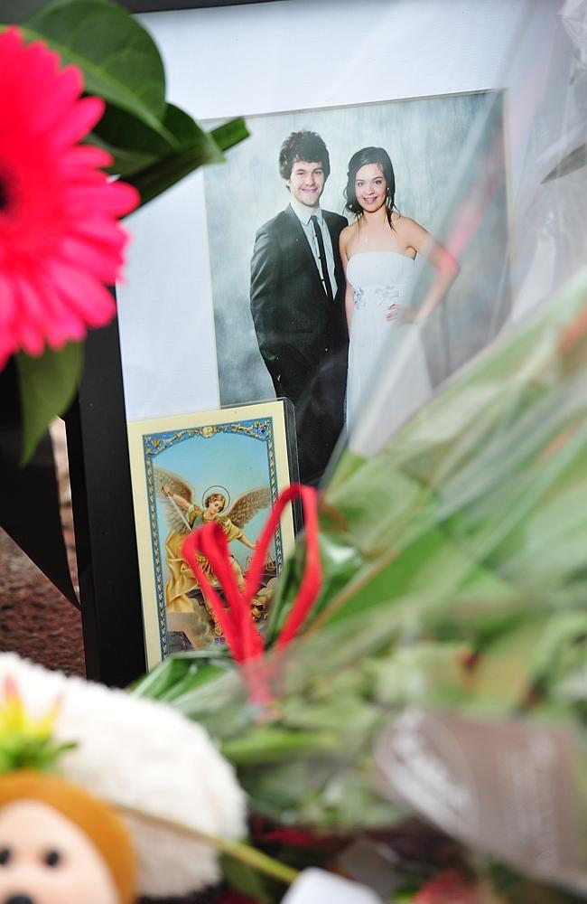 Mourners lay flowers in memory of the three people killed by a brick wall that collapsed in Swanston street, Melbourne on Th...