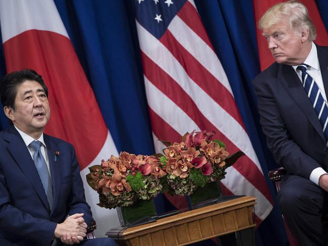Japan's Prime Minister Shinzo Abe makes a statement for the press while US President Donald Trump listens. Picture: AFP