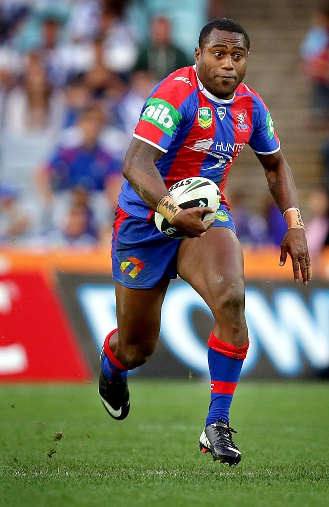 Newcastle Knights winger Akuila Uate makes a break. Picture Gregg Porteous
