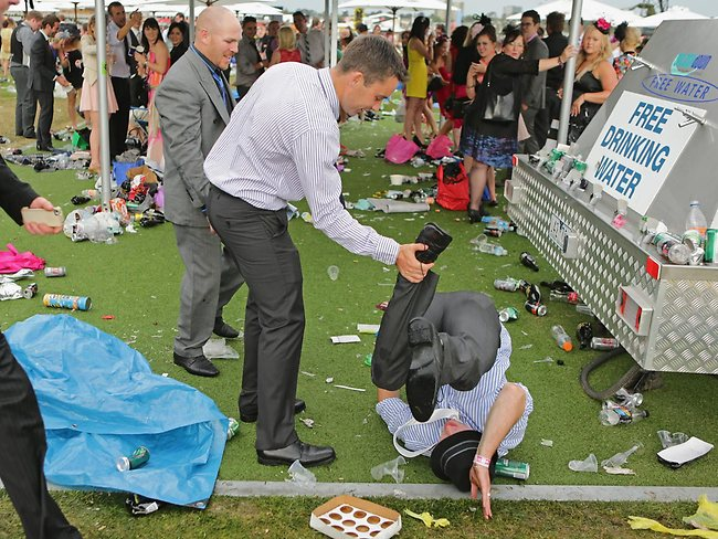 There's a faller at Flemington! A racegoer takes a tumble after the Melbourne Cup at Flemington Racecourse. Getty