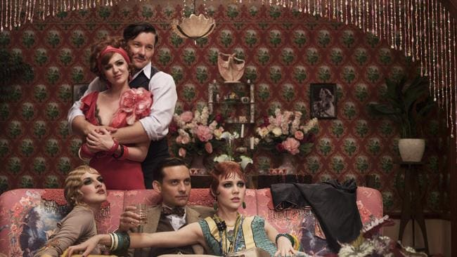Sequins and cinema ... Edgerton with Isla Fisher and Tobey Maguire in The Great Gatsby. Picture: Supplied.