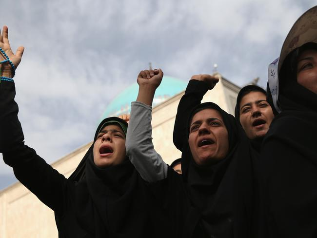 Tensions ... people shout anti-America slogans at the shrine to the Ayatollah Khomeini on the 25th anniversary of his death on June 4, 2014. Picture: John Moore