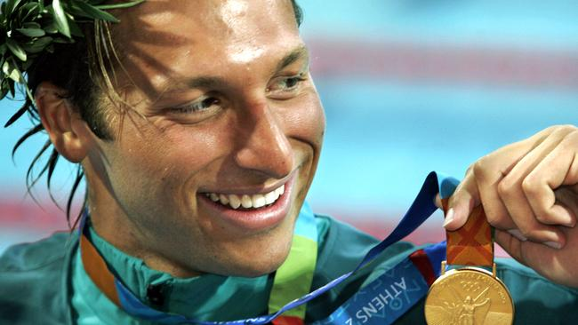 Champion Ian Thorpe with one of his many gold medals.