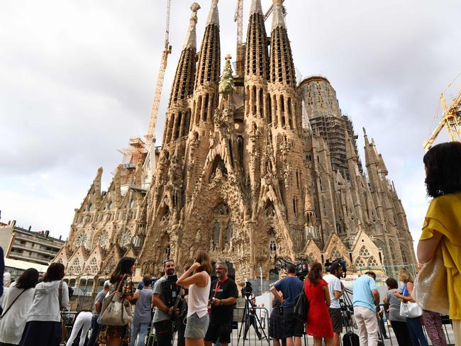People gather at the iconic Sagrada Familia basilica in Barcelona. Picture: AFP/Pascal Guyot