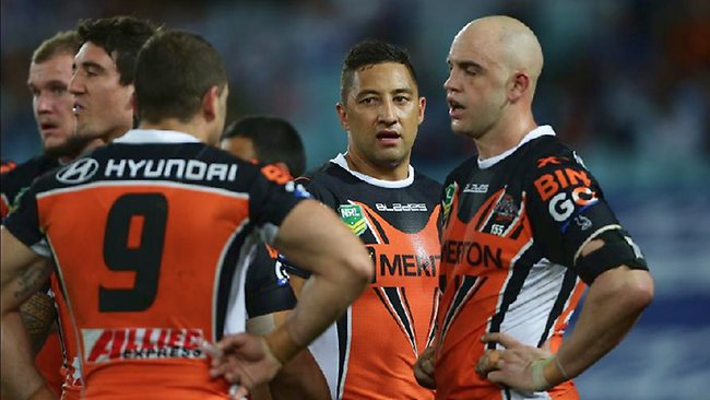Wests Tigers players Benji Marshall (centre) and Liam Fulton (right) after a Bulldogs try. Picture: Brett Costello