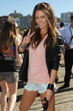 <p>Former Miss Universe finalist Erin McNaught at Bondi Beach watching the Davenport show . Picture: Dean Marzolla</p>