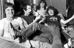<p>Band AC/DC on tour bus in 1976 (L-R) Mark Evans, Bon Scott, Phil Rudd, Malcolm Young & Angus Young. Pic. Gary Graham</p>