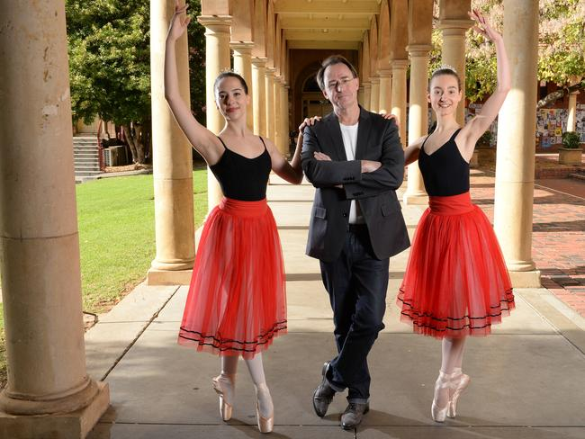 North Adelaide composer Graeme Koehne with young ballerinas Lana Barone and Samantha Mattner from Terry Simpson Studio. Picture: Campbell Brodie.