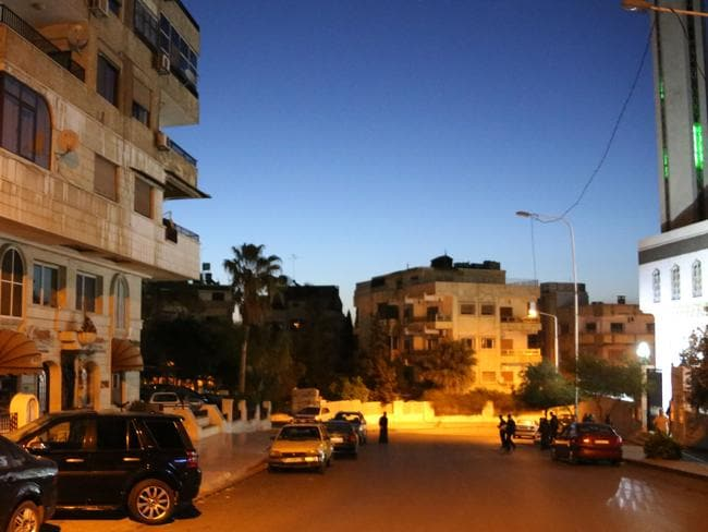 Men are seen leaving a mosque in Damascus' Mazze neighbourhood after the daybreak Muslim prayer. Picture: AFP