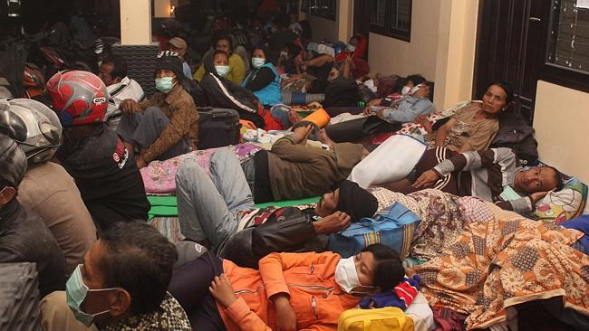 Evacuated ... Villagers sleep at a temporary shelter after they were evacuated from their homes on the slope of Mount Kelud in Kediri, East Java. Pic: AP Photo