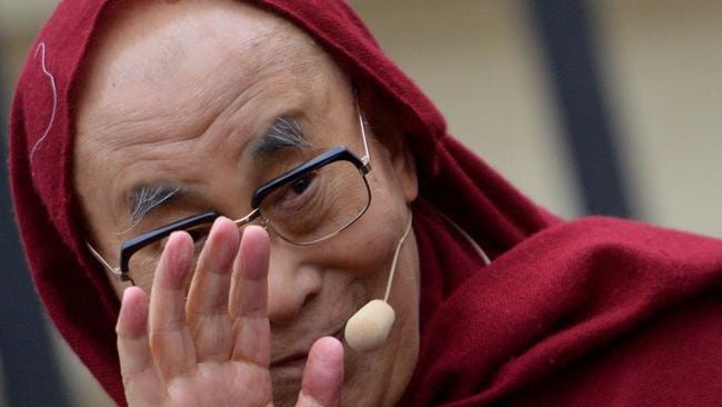 The Dalai Lama gestures before a speech. Picture: AFP