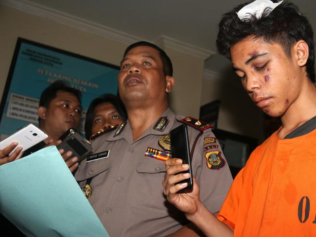 Police parade the snatching suspect, Kiki Irfani, to journalists after an interrogation at the police station in Kuta, Bali. Picture: Lukman S. Bintoro