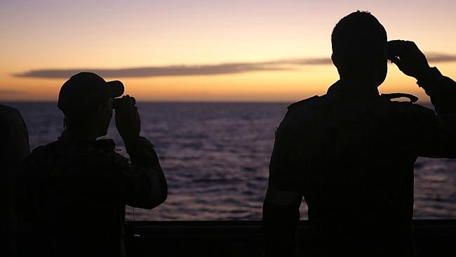Fading hopes... Crew on HMAS Toowoomba scan the seas for signs of the missing jet.