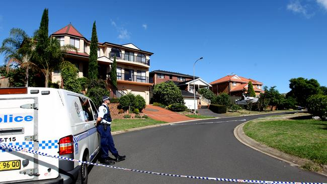 Police tape off a number of properties the morning after construction worker Gemahl Maika was executed outside his home in Glen Alpine in 2011.