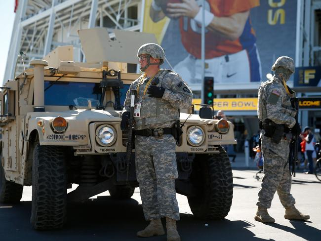 Military police officers patrol outside Super Bowl 50 at Levi's Stadium.