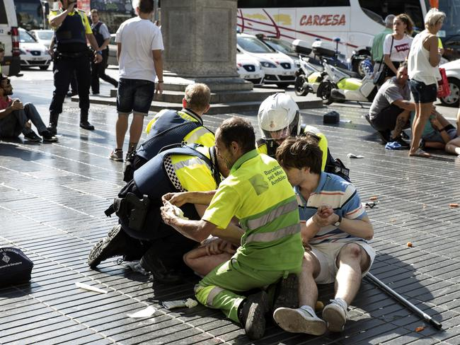 Emergency workers helping victims. Picture: Getty Images