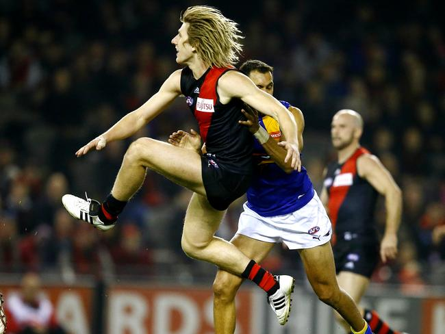 Dyson Heppell kicks the Bombers into attack. Picture: Wayne Ludbey