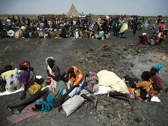 A large number of people wait for food air-drops by the International Committee of the Red Cross outside Thonyor, in South Sudan.