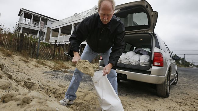 As America's biggest city braces for the storm, so do ordinary homeowners out to protect their own properties with sandbags. Picture: AP