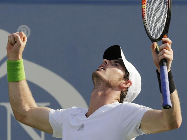 Andy Murray celebrates his victory over Tsonga, setting up a blockbuster quarter-final against Novak Djokovic.