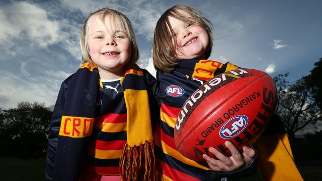 Cancer survivor Summer Harper, 5, left, with sister Abby, 4. They will be honorary Crows mascots at Sunday's Showdown. Picture: Tait Schmaal.