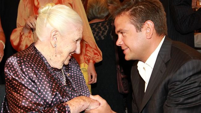 MANY HAPPY RETURNS: Dame Elisabeth Murdoch celebrates her 102nd birthday at the Melbourne Recital Centre, congratulated by grandson Lachlan Murdoch. Picture: Stuart Mcevoy.