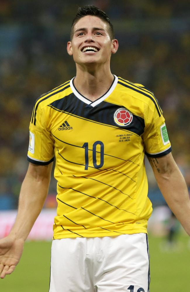 Colombia's James Rodriguez celebrates after he scored his side's second goal against Uruguay.