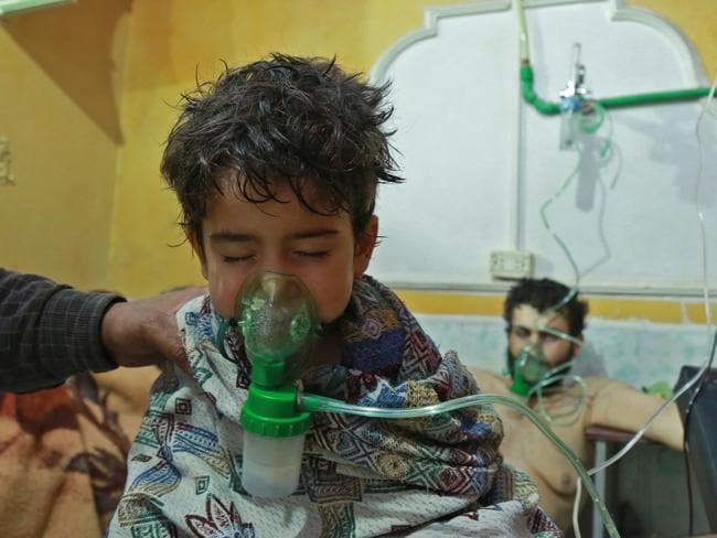 Syrian children and adults receive treatment for a suspected chemical attack at a makeshift clinic on the rebel-held Eastern Ghouta region. Picture: AFP