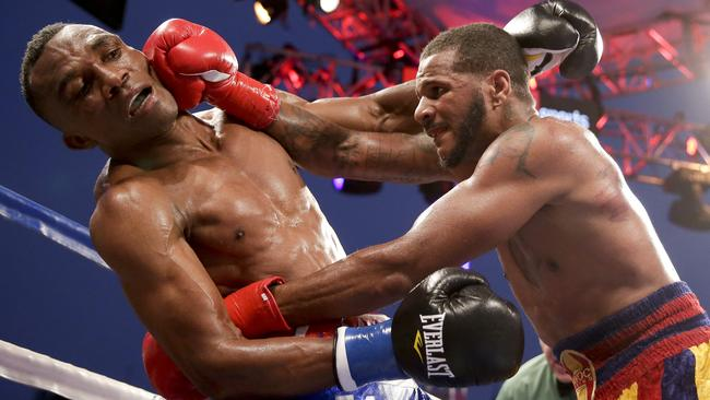 Sakio Bika, left, gets hit by Anthony Dirrell during their WBC super middleweight title bout.