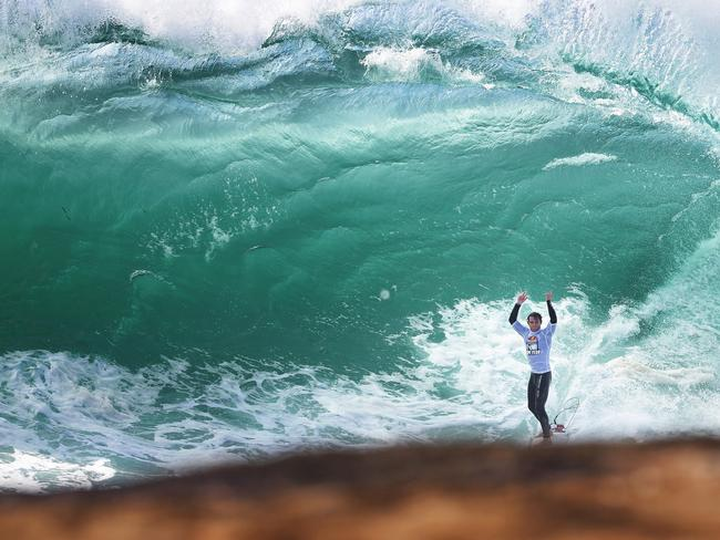 Jesse Polock celebrates after making a wave during the Red Bull Cape Fear surfing event at Cape Solander, Sydney. Pic Brett Costello