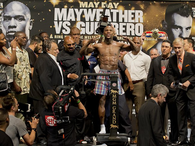 Mayweather shows off his training camp body. Picture: Julie Jacobson.