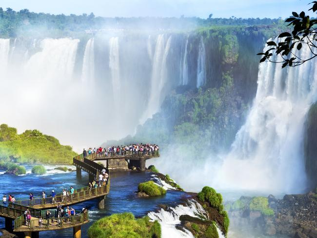 Tourists at Iguazu Falls, one of the world's great natural wonders, on the border of Brazil and Argentina. Picture: iStock