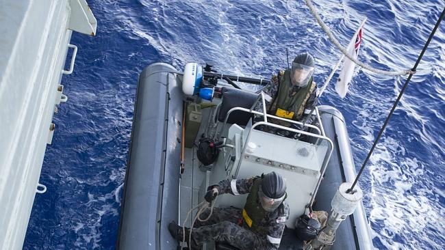 One of HMAS Darwin's rigged hull inflatable boat transports seized heroin from a boarded