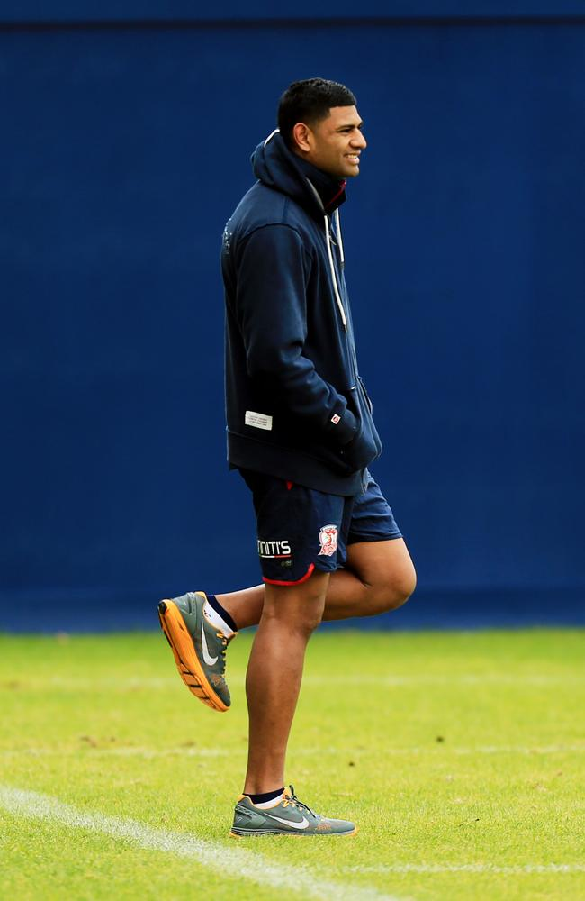 Daniel Tupou watches Roosters training.