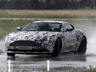 Photos of a 2016 Aston Martin prototype being test driven on a track in Italy