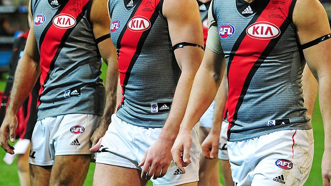 Dejected Essendon players depart the MCG after another loss late in the season last year. Picture: George Salpigtidis