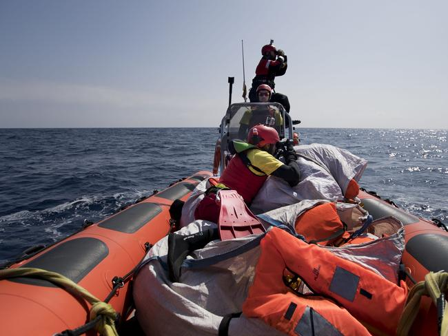 Proactiva Open Arms crew search for missing refugees whose boat sank off the coast of Libya. Picture: AP Photo/Bernat Armangue