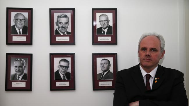 Senator John Madigan with pictures of some of his predecessors in Canberra. .