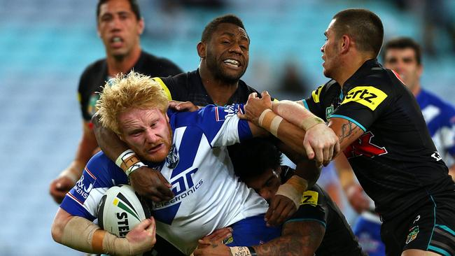 The Panthers get to grips with James Graham.