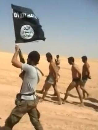 A video grab shows men being marched barefoot along a desert road before allegedly being executed by Islamic State militants in Syria. Picture: AFP